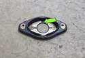 When installing a new gasket, be sure that the black stripe is facing up (green arrow).