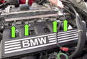 Normally aspirated engine: Next, remove the four 10mm fuel rail fasteners (green arrows).