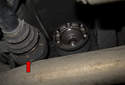 Remove the drive axle from the axle stub flange.