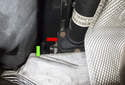 The flex-disc (red arrow) is just out of sight and is tucked above and forward of the transmission cross member (green arrow).