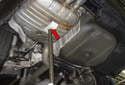 Place a screw jack or hydraulic jack under the rear muffler (red arrow).