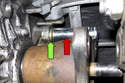 To install a new seal, use a 16mm deep socket (red arrow) and tap the seal (green arrow) in until it bottoms out in the transmission housing.