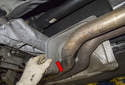 Once the heat shield is free, move it down and away from the body and toward the rear of the vehicle.