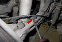Next, use a flathead screwdriver to lever open the front most locking tab (red arrow).