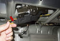 Latch: Then, pull the latch out just enough to access the electrical connector.
