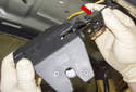 Latch: Slide the cables out of the latch and remove the latch from the vehicle.