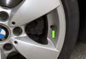 A rubber, flexible valve stem (green arrow) utilizes wheel speed.