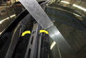 Left wiper blade adjusting: Slide the wiper arm up or down to adjust the blade angle to the windshield (yellow arrows).