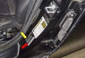 The VIN is also located on the driver doorjamb, vehicle identification sticker (red arrow).