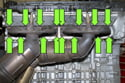 Remove the exhaust manifold fasteners (green arrows).