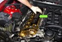 Remove the plastic camshaft cover from the cylinder head by pulling it up and off the cylinder head.