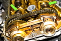 Rotate the engine clockwise until the first camshaft lobes point toward each other (green arrows).