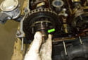 Pull the splined shaft out of the exhaust camshaft and store it with the other exhaust camshaft components.