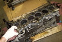Next, remove the cylinder head gasket from the cylinder head.