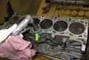 Remove all of the old head gasket material from the block.