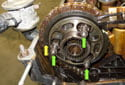Check that the arrow (yellow arrow) on the exhaust sprocket is still aligned with the cylinder head sealing surface.