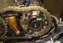 Remove the secondary timing chain and camshaft sprockets from the tool.