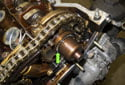 Slide the splined shaft onto the intake camshaft until you can only see 1mm of the splines (green arrow).
