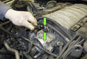 Working at the front of the intake manifold, squeeze the collar (green arrows) while pulling the hose off the intake manifold.