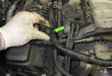 Follow the hose to the right side valve cover.