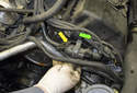 Then pull the purge solenoid off the mounting bracket (yellow arrow) in the direction of the green arrow.