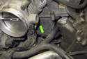 Then push the coolant hose (green arrow) under the breather hose connection pipe.