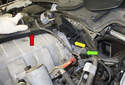 Lift the wiring junction (red arrow) up and away from the intake manifold.