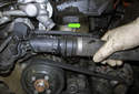Next, remove the coolant hoses from the thermostat housing.