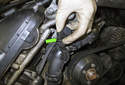 Working at the top of the thermostat housing, locate the thermostat electrical connector.