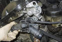 Remove the thermostat and thermostat housing from the engine.