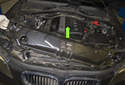 Lift the radiator support in the direction of the green arrow to remove it.