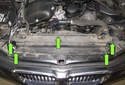 Working at the top of the radiator, remove the five T25 Torx fasteners (green arrows).