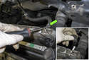 Working at the left side of the radiator, remove the hose clamp (green arrow) from the radiator vent hose.