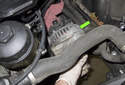 Next, remove the alternator from its mounting bracket by rocking it back and forth while pulling up and off the bracket.