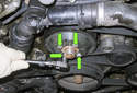 Before removing the engine drive belt, loosen the four 10mm water pump pulley fasteners (green arrows).