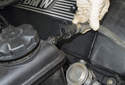 Then remove the upper hose from the coolant expansion tank by pulling it straight off.