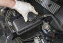 Draining cooling system: Working in the engine compartment, remove the expansion tank cap.