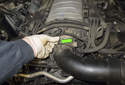 8-cylinder engine: Working at the intake air duct, pull the vacuum line (green arrow) off the air duct.