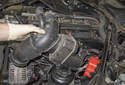 Then, pull the intake air duct off the throttle housing and remove it from the engine.