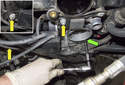 Working next to the throttle housing, remove the three 10mm nuts and bolts from the wiring harness junction.