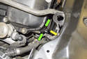 Exhaust camshaft sensor: Working at the right front of the cylinder head, disconnect the camshaft sensor electrical connector by pressing the release tabs (green arrow) and pulling it straight off in the direction of the yellow arrow.