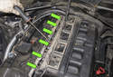 Then release the fuel injector harness strip from the fuel injectors and remove it.