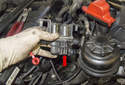 Remove the heater valve from the vehicle.