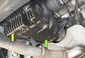 This photo shows a leaking rear differential, covered in oil (green arrow).