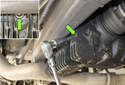 To check your rear differential fluid level, using a 14mm or Allen bit, remove the oil fill plug (green arrow).