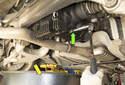 Next, using a 14mm Allen bit, remove the differential oil drain plug (green arrow).