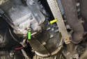 Working at the right side of the transmission, remove the 17mm fill plug (yellow arrow).