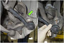 Next, remove the 16mm tie rod end nut (green arrow).