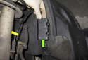 Front sensor: Working behind the front strut (yellow arrow), open the plastic door (green arrow) for the ABS sensor electrical connector.