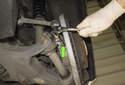 Rear sensor: Working at the rear wheel bearing carrier, remove the ABS sensor 5mm Allen fastener (green arrow).